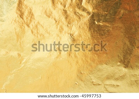 Golden foil abstract texture background - stock photo
