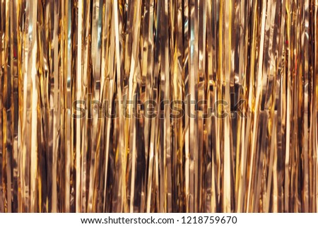 Golden foil tinsel strips, christmas or festive decoration background #1218759670