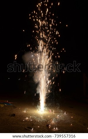 Golden Fountain - Firework Volcano Emitting Sparks on Dark Brown Background - New Years Eve Celebration Element. Little Fireworks, Pyro, Glistening, Particle Effect.