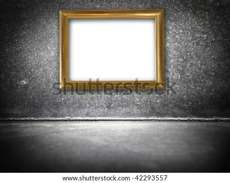 Golden frame in a black stone interior