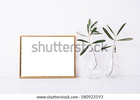 Golden frame mock-up on white wall #580923193