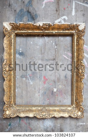 Golden frame with wooden background
