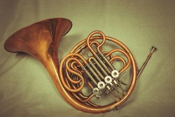 Golden french horn with Classic Background