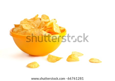 Golden fresh chips in the yellow bowl