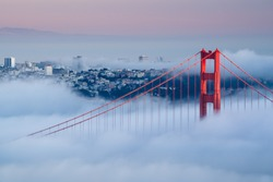 Golden Gate at dawn surrounded by fog