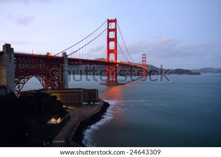 Golden Gate Bridge and Fort Point in the early dusk on a spring morning. Landscape (horizontal) orientation.