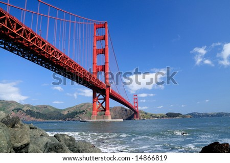 Golden Gate Bridge and rocks as seen from Fort Point, San Francisco, California.