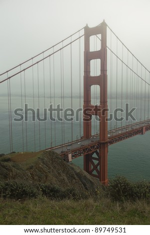 Golden Gate Bridge and San Francisco Bay, during foggy morning