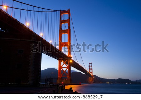 Golden Gate bridge at night with long shutter speed, long exposure photography.