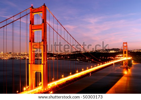 Golden Gate Bridge glowing at night