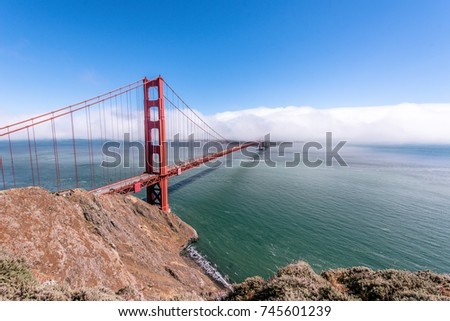 Golden Gate Bridge in clouds on a beautiful summer day  - Panoramic view from Battery Spencer - California, USA