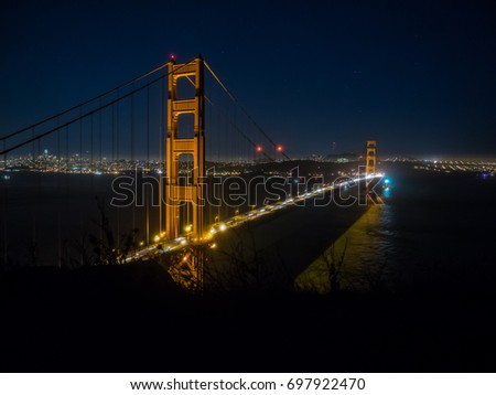Golden Gate Bridge is a suspension bridge spanning the Golden Gate strait,  channel between San Francisco Bay and the Pacific Ocean. #697922470