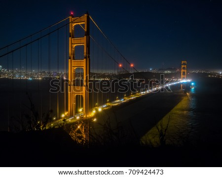 Golden Gate Bridge is a suspension bridge spanning the Golden Gate strait,  channel between San Francisco Bay and the Pacific Ocean. #709424473