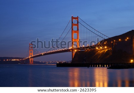 Golden Gate Bridge is glowing in the dusk - as seen from Fort Baker in Sausalito, California.