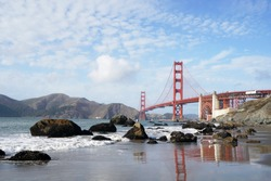 Golden Gate Bridge is Red Bridge seen from Baker Beach in San Francisco, California, United states , USA - Holiday Travel famous building Landmark - Nature Park and outdoor sightseeing