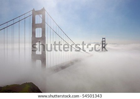 Golden Gate Bridge is shown in a fog by the shined sunlight , San Francisco, California