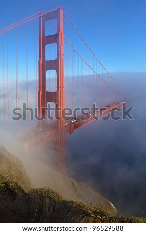 Golden Gate Bridge is shown in a fog , San Francisco, California