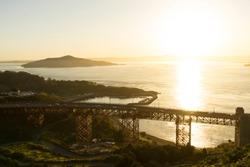 Golden Gate Bridge over looking Fort Baker at sunrise in San Francisco