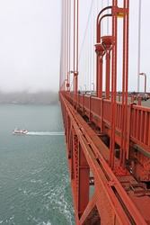 Golden Gate Bridge, San Francisco, USA - an engineering masterpiece, art deco steel construction in orange with details such as lighting, outlining the cables and towers