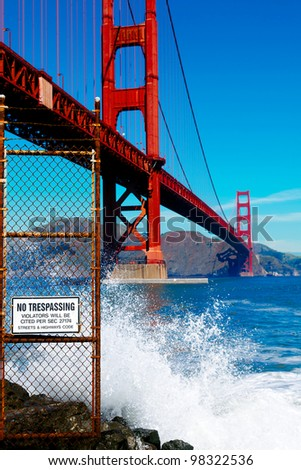 Golden Gate bridge with dangerous rocks and sign that says No Trespassing