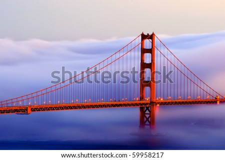 Golden gate in fog at sunset