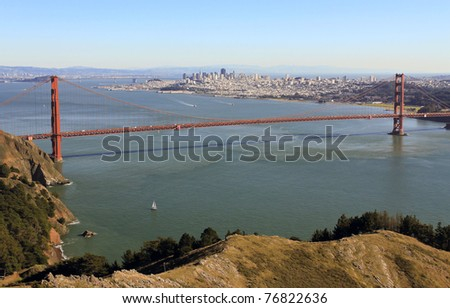 GOLDEN GATE NATIONAL RECREATION AREA, CALIFORNIA: Golden Gate Bridge taken from Hawk Hill overlook in Marin County near Sausalito with sailboat in foreground.