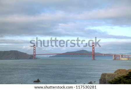 Golden Gates bridge in San Francisco bay on a cloudy day - stock photo