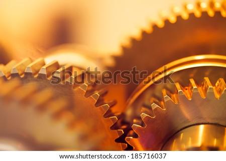 Stock Photo golden gear wheels, close-up