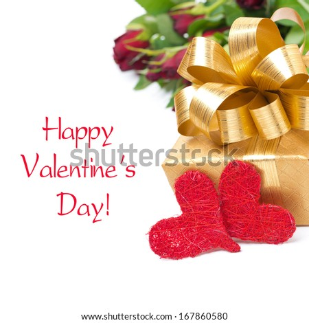 golden gift box, two red hearts and flowers, isolated on white