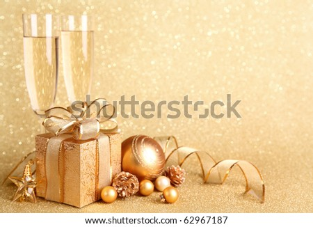 Golden gift box with glasses of champagne