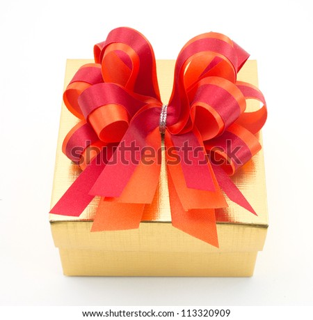 Golden gift box with red bow isolated on white background