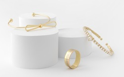 Golden girl accessories two golden bracelets and ring on white background