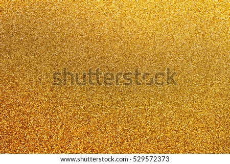 Golden glitter background with little sparkles. Festive backdrop fot your text or design.