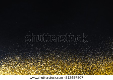 golden glitter sand texture border on black abstract background with copy space yellow dusty
