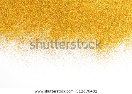 Golden glitter sand texture spread on white, abstract background with copy space. Yellow dusty shimmer decoration border, shiny and sparkling. Holidays and glamour concept.