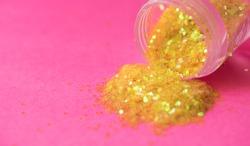 Golden glitter spillage textured background abstract