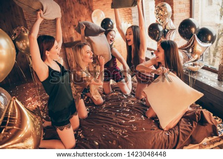 Golden glossy glamorous decoration bride bridal shower. Five stunning classy chic divas ladies ecstatic guests fellows holding pillows in hand enjoy special time in unity diverse company sheets linen