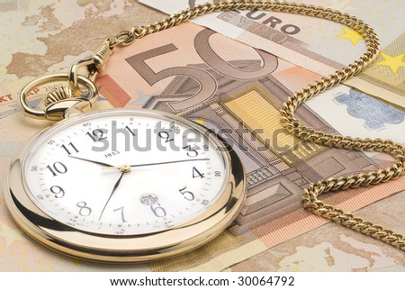 Golden glossy pocket watch on 50 Euro banknotes