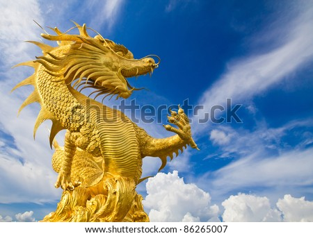 Golden gragon statue on blue sky