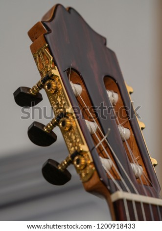 golden guitar headstock - Shutterstock ID 1200918433