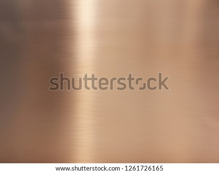 Golden hairline stainless steel. Shiny gold foil, bronze, or copper metal pattern surface texture. Close-up of interior material for design decoration background