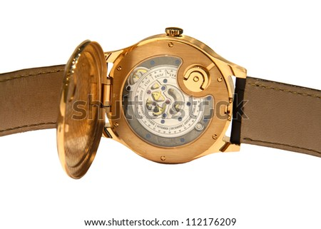 Golden hand made swiss watch on a leather belt, isolated on white background