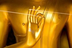 Golden hand of image Buddha close up.