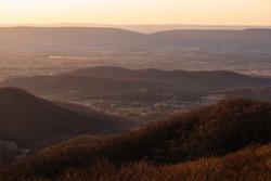 Golden haze down in the Shenandoah Valley of Shenandoah National Park at sunset.