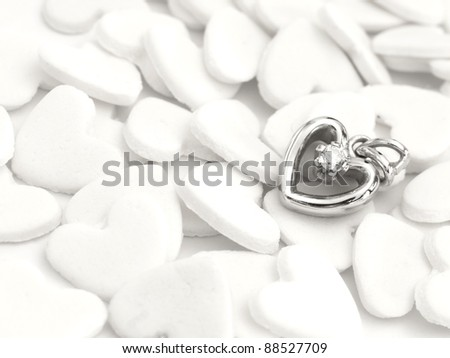 golden heart with gem on the white hearts background