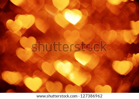 golden hearts bokeh background - stock photo