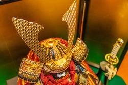 Golden helmet of Japanese samurai doll
