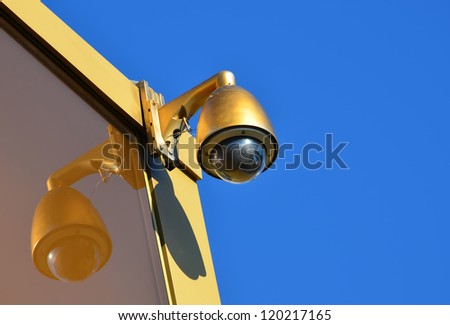 Golden Hi-tech dome type camera and a blue sky