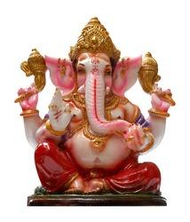 Golden Hindu God Ganesha over a white background