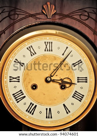 Golden historic clockface with Roman hours